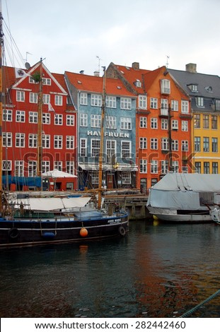 COPENHAGEN, DENMARK: DEC 30, 2014 - Nyhavn is a waterfront, canal and entertainment district in Copenhagen. It is lined by brightly coloured townhouses and bars, cafes and restaurants. - stock photo
