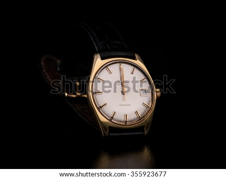 COPENHAGEN, DENMARK - DECEMBER 27 2015: Omega Geneve Automatic vintage wristwatch on black background, hands showing 00:00:01 on the 1st of the month on December 27 2015 in Copenhagen, Denmark