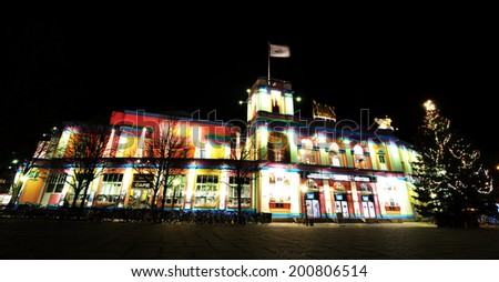 COPENHAGEN, DENMARK - DECEMBER 18, 2011: Palads (Palace) Theatre's colorful building at Christmas. Palads Theatre is a Cinema in Copenhagen, part of the chain Nordisk Film Cinemas.