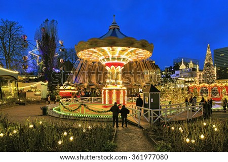 COPENHAGEN, DENMARK - DECEMBER 14, 2015: The carousel and christmas illumination in Tivoli Gardens, a famous amusement park and pleasure garden. Tivoli is the most-visited theme park in Scandinavia. - stock photo