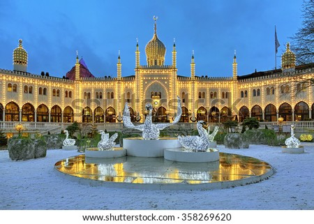 COPENHAGEN, DENMARK - DECEMBER 14, 2015: The Christmas installation with Swans in front of the Moorish Palace in Tivoli Gardens. Since 2008 in the palace located the five-star boutique hotel Nimb. - stock photo