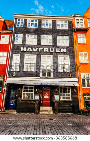 COPENHAGEN, DENMARK - JANUARY 3, 2015: Nyhavn district is one of the most famous landmarks in Copenhagen with typical colorful houses and water canals.