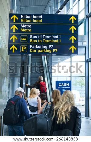 COPENHAGEN, DENMARK - JULY 1: Travelers at the airport on July 1, 2014 in Copenhagen - stock photo