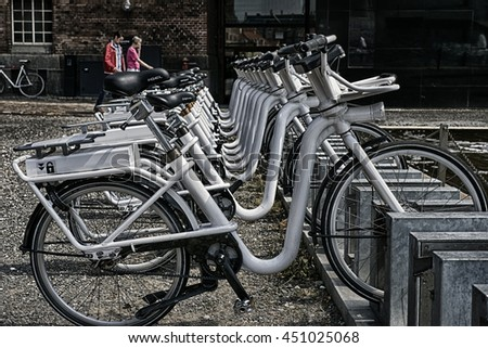 COPENHAGEN, DENMARK - JUNE 23: Bicycles ready for renting in the city center on June 23, 2016 in Copenhagen, Denmark. - stock photo