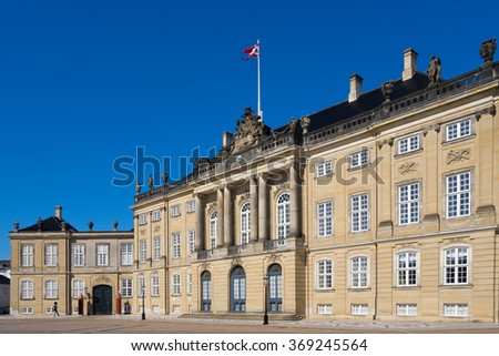 COPENHAGEN, DENMARK - JUNE 05, 2015: Guard walks in front of the Amelienborg Palace in the Danish capital city Copenhagen. It is a residence of the Danish royal family. - stock photo