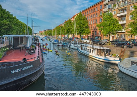 COPENHAGEN, DENMARK - 24 JUNE, 2016: Houses among the river in the old town of Copenhagen, Denmark on 24 June, 2016. Copenhagen is the capital and most populated city of Denmark.