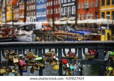 COPENHAGEN, DENMARK - JUNE 8: Many love padlocks locked on iron chain at landmark Nyhavn in Copenhagen, Denmark. June 8, 2016 - stock photo