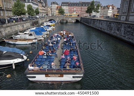 COPENHAGEN, DENMARK - JUNE 23: Tour boat in Frederiksholm Canal - View from Marble Bridge June 23 2016 Copenhagen, Denmark. - stock photo