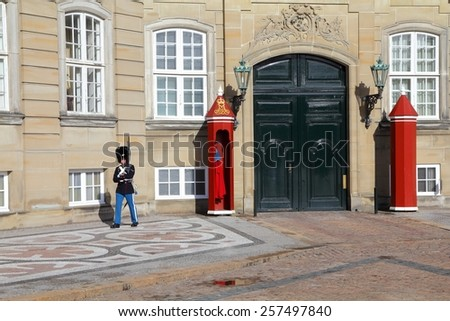 COPENHAGEN, DENMARK - MARCH 11, 2011: Guard patrols Amalienborg Palace courtyard in Copenhagen, Denmark. Cophenhagen is the most visited city in Nordic countries with 1.3 million annual tourists.