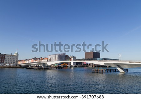 Copenhagen, Denmark - March 16, 2016: Inner Harbour pedestrian and cyclist bridge connecting Nyhavn and Christianshavn. - stock photo