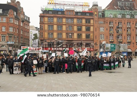 COPENHAGEN, DENMARK - MARCH 18: People protesting against Bashar al-Assad politic in Syria on City Hall Square on March 18, 2012 in Copenhagen, Denmark - stock photo