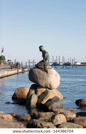 COPENHAGEN, DENMARK - OCTOBER 28 : Little Mermaid statue sitting on a rock on the harborfront in the northern Kastellet area on October 28, 2012 in Copenhagen, Denmark - stock photo