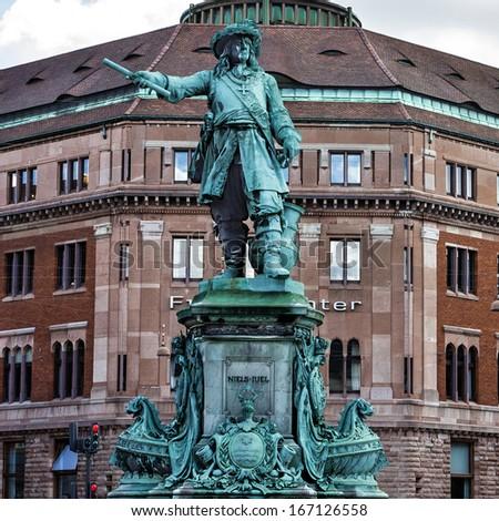 COPENHAGEN, Denmark: Old building of Danish bank and monument for Niels Juel. - stock photo