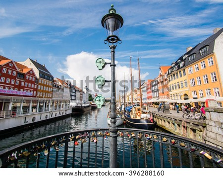 COPENHAGEN, DENMARK - SEPTEMBER 04: Nyhavn district on September 04, 2015 in Copenhagen, Denmark. This is one of the most famous landmark in Copenhagen. - stock photo