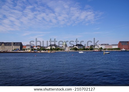 Copenhagen harbor on a sunny day with a view to Frederik's Church known as The Marble Church