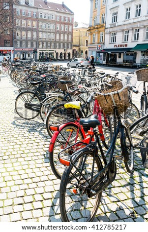 COPENHAGEN - MAY 2015 : Lots of bycicles parked on line in Copenhagen in a beautiful spring warm day.