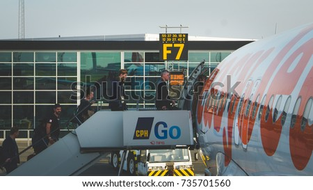 Copenhagen, September 8, 2017: Passengers of EasyJet airline enter the aircraft parked at the terminal gate