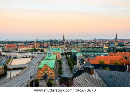 Copenhagen view from above Christiansborg. Our Savior church spire, old stock exchange building, bridges over canal. Vantage point Cobenhavn wide angle view. - stock photo
