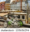 COPENHAGEN: Waterfront Nyhavn in the center of Copenhagen. Nyhavn is a historical district in Copenhagen. It is lined by brightly colored townhouses and restaurants. Denmark. - stock photo