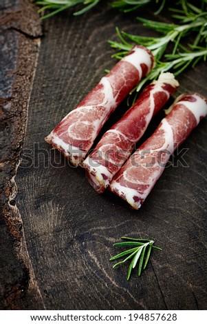 Coppa pork collar ham. Cold cuts on wood. Rustic ham prosciutto - stock photo