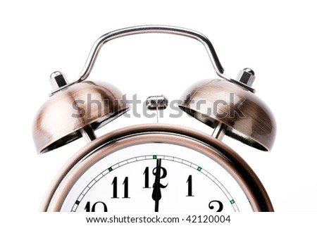Copper alarm clock with bells on white background