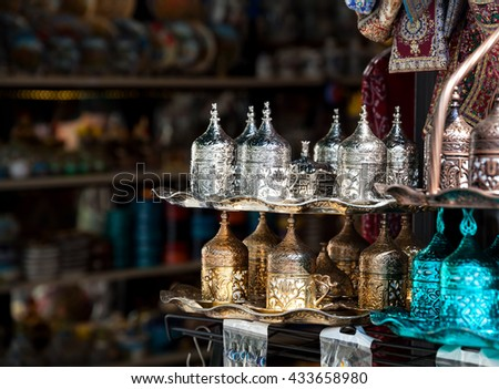 Copper and silver Turkish coffee sets at Istanbul market - stock photo