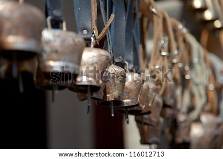 Copper bells hooked on a stick.