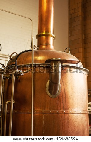 Copper boil kettle in the American brewery - stock photo