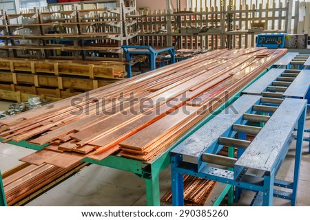 Copper busbar in factory of Electrical switchboard manufacture - stock photo