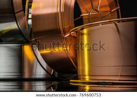 copper cable factory, electric welding, on a black background