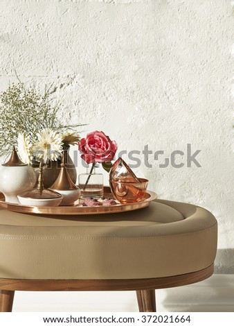 copper coffee table  and puff seat with modern brick wall decoration - stock photo