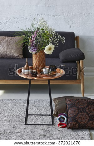 copper coffee table  and sofa with modern brick wall decoration - stock photo
