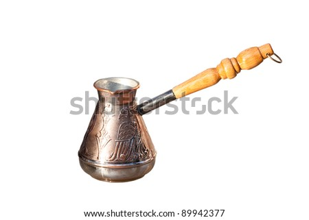 copper coffeepot with long handle on white - stock photo