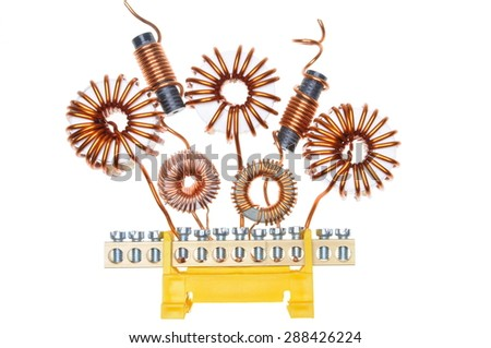 Copper coils and wires, abstract energy industry - stock photo