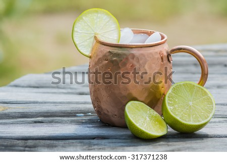 Copper cup or mug with lime slice and ice. - stock photo
