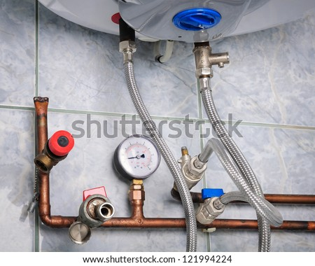 Copper heating pipes system close up - stock photo