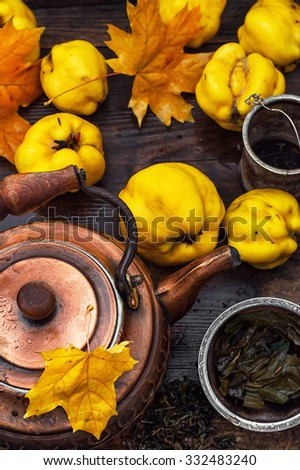 Copper kettle brewing and quinces in an old stylish derevna box - stock photo