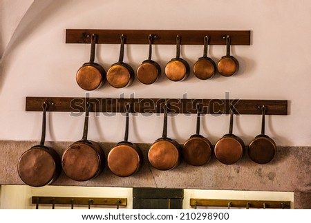 Copper kitchen utensil on the wall - Interior of royal kitchen in National Palace of Sintra, Portugal - stock photo