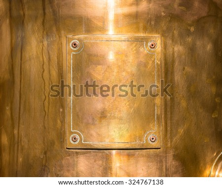copper or bronze frame with rivets. - stock photo
