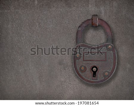 copper padlock on a heavy metal rusty  old steel plate, with space for text or symbol - stock photo