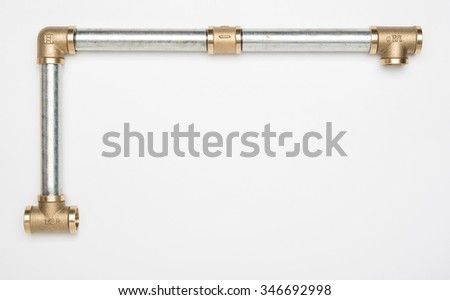 Copper pipe connectors and threaded iron pipe - stock photo