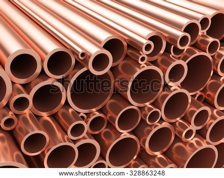 Copper pipes. Heap of round metal tubes.