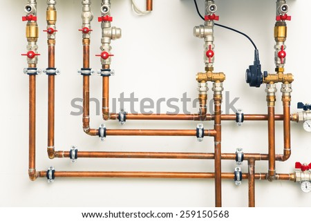 copper pipes in boiler-room - stock photo