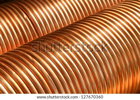 copper spiral parts in a manufacturing factory - stock photo