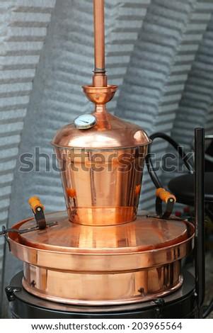 Copper still apparatus for distilling alcohol - stock photo