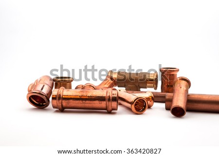 copper various pieces on an white background