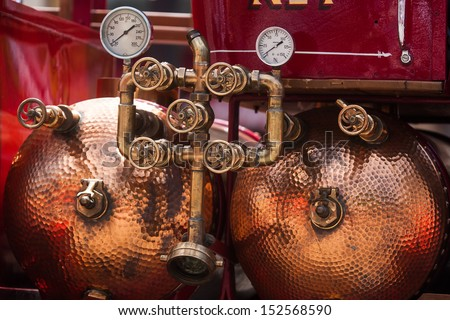 copper water tanks on a vintage fire truck - stock photo