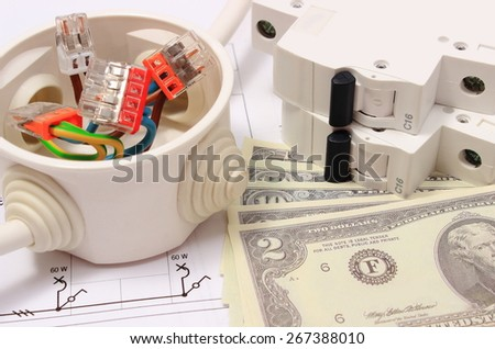 Copper wire connections in electrical box, electric fuse and money on construction drawing of house, concept for engineering and energy savings - stock photo