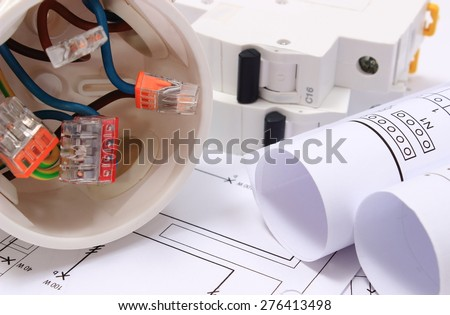 Copper wire connections in electrical box, rolls of electrical diagrams and electric fuse on construction drawing of house, accessories for engineering work, energy concept - stock photo