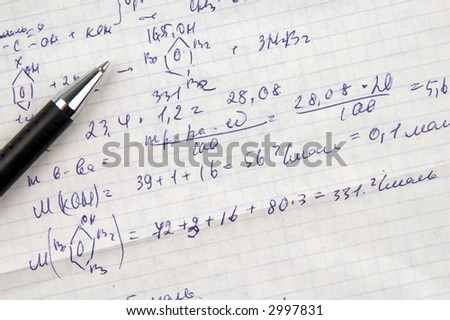 Copy-book sheet of paper with formulas and pen - stock photo
